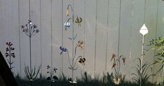 Cut-out fence with painted grass. Steve saw this in an alley and loved it.