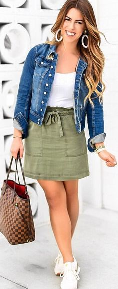 #spring #outfits woman wearing blue denim button-up jacket, white inner shirt and green mini skirt outfit. Pic by @baileyschwartz