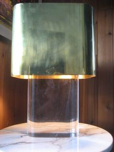 A Karl Springer Lucite Lamp with Brass Shade | From a unique collection of antique and modern table lamps at https://www.1stdibs.com/furniture/lighting/table-lamps/