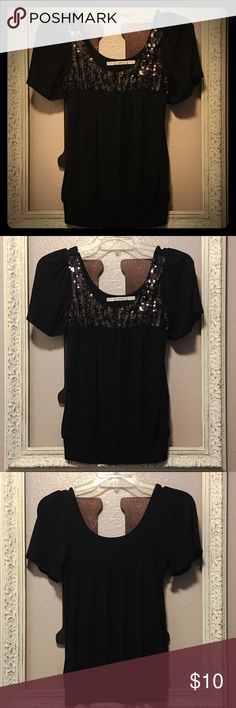 Black Sequin Banded Bottom Blouse by Gibson Black Sequin Banded Bottom Blouse by Gibson. New without tags. Size medium. Material content pictured. Smoke free home. Gibson Tops Blouses