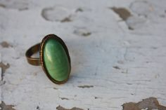 Vintage Oval Green Stone and Copper Tone Oversized Costume Jewelry Ring Size 8. $24.99, via Etsy.