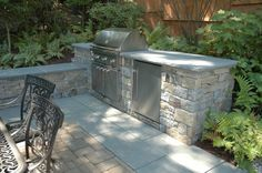 (build a bbq area...but with CHARCOAL grill...very important. Gas grill=bad taste)