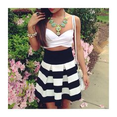 Crop top, skirt and necklace.