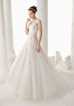 Nenufar is a beautiful dress with a chapel length train, button loop back and high illusion lace bateau neckline over a strapless, sweetheart bodice. This bridal ball gown is perfect for the bride who wants to be both sophisticated and feminine on her wedding day.