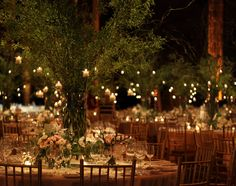 Tree like centerpiece with hanging candles.
