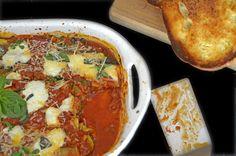 Zucchini Lasagna featuring fresh mushrooms and microgreens layered in a marinara sauce with fresh basil and Parmesan cheese.