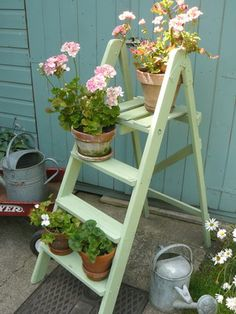 i love this! ill be on the look out for an old wooden ladder that i can paint up and a couple old watering cans! What fun we can have painting them!