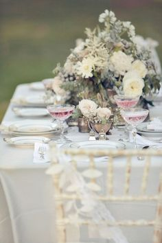things i love: champagne saucers, pink champagne, wild-looking flowers.