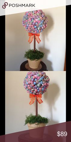 "Dum Dum Candy Topiary Spoil someone with this delectable topiary containing over 400+ Dum Dum Lollipop Candies. This sweetness will be happily enjoyed by all over the holidays or at any upcoming event.  Great for: -Weddings -Housewarming  -Baby Showers -Office Party -Birthday/Birthday Parties -Just Because -Going Away Gift -Promotion  Topiaries come in a clay pot which is 4 1/2"" H. The finished product stands 22 ½""H.  This item is made to order. Other"
