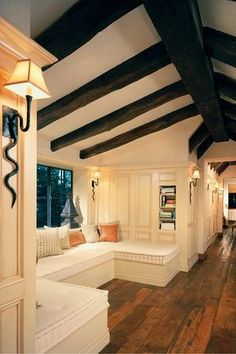 Traditional Hallway with Exposed beam, Decorative Pillow, Window seat, Serpent wall sconces, Built-in bench seating
