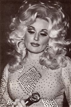 Dolly Parton. The original bling queen. It took the rest of the world 20 years to wear her style.