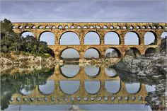 The Pont du Gard is an ancient Roman aqueduct bridge that crosses the Gardon River in Vers-Pont-du-Gard near Remoulins, in the Gard département of southern France. Monuments, France Wallpaper, Pont Du Gard, Visit France, Ancient Rome, Ancient Ruins, France Travel, Roman Empire, The Great Outdoors