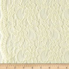 Supreme Lace Ivory from @fabricdotcom  Delicate and classic, this sheer lace has finished scalloped edges on both sides, and a 25% mechanical stretch across the grain for comfort and ease. This lace fabric appropriate for lingerie, overlays on skirts or dresses, feminine apparel accents, and wraps or shrugs.