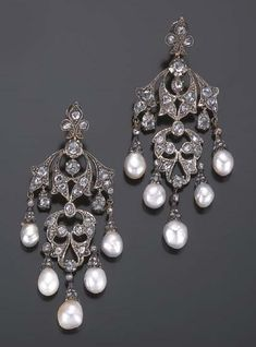 A PAIR OF PEARL AND DIAMOND GIRANDOLE EARRINGS. Set with rose -cut diamonds, each suspending five fine baroque pearl pendants, mounted in silver and gold, circa 1860.