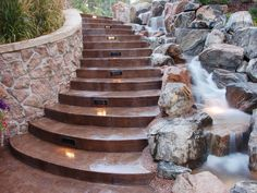 Stairs with rocks and water feature.