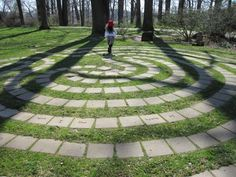 [Paved labyrinth in the park at the edge of a woods.]