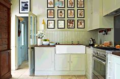 In the kitchen pressed flower pictures hang above a double butler's sink