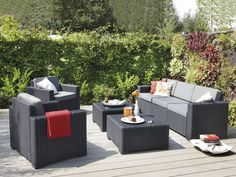 Awesome Outdoor Sofa Rattan Furniture Design with Black Color and 2 Square Tables Also Using Wood Flooring
