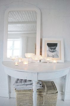 What a creative way to set up candles. So serene. The simple charm of this little table is lovely.