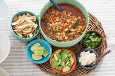Pork & Hominy Pozole with Avocado & Crispy Tortilla Strips. Visit https://www.blueapron.com/ to receive the ingredients.