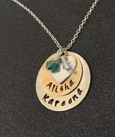 A personal favorite from my Etsy shop https://www.etsy.com/listing/211543235/hand-stamped-family-tree-necklace-hand
