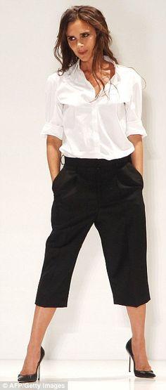 Victoria Beckham.. white shirt and high waisted cropped black trousers, both from her SS14.. paired with Manolo Blahnik stiletto court shoes..post-show of her SS 2014 collection..