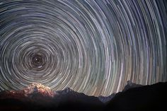 Photographer Anton Jankovoy spent months camping at the foot of Chomolungma (Mount Everest) in a bid to capture the perfect picture of star trails over the Himalayas. Anton, from Zhytomyr in Ukraine, used a Canon EOS 5D Mark II with a 24mm lens to capture this picture, leaving the shutter open for several hours