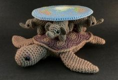 Behold the awesome!  The Discworld!  In Crochet!  You could snuggle the Great A'tuin!  (If you don't know what I'm talking about, start reading Terry Pratchett.  NOW!)