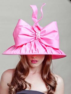 This Derby hat has a lot going on.  It almost looks like a lampshade.  Mole Detective loves the sun protection but maybe noto the style so much.  But hey, its the Derby so why not go all out?  (www.moledetective.com)