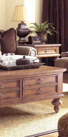 I LOVE furniture with dual purposes. Laptops, ipads, remotes...in drawers! Timeless mahogany 4 drawer coffee table - a fresh take on traditional style