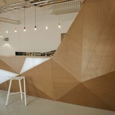 just. glorious.    Faceted wooden bar in the Muzeum Sztuki Cafe by Polish design studio Wunderteam. Lodz, Poland.