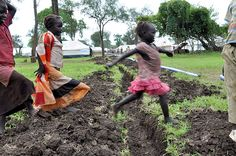 Gendrassa refugee camp: Heavy rains in South Sudan via The Guardian (Alun McDonald) Camping Life, World, Pictures, Economics, Pipes, Photograph, Water, Boys Playing, Infancy