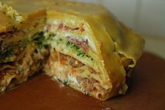 A crazy lasagna pie loaded with different sauces, meats and cheeses
