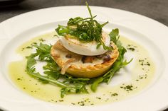 Wild mushroom tart topped with crisp rocket & goats cheese