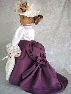 Victorian-fits-American-Girl-18-Doll-Silk-Walking-suit-1800-LittleCharmers. This gored a-line silk skirt closes at the waist with a snap. It is swept up into a bustle with a self fabric bow and a lovely sweeping train. Lace trimming adorns the ivory gored slip and bloomers, not shown.