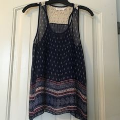 Navy blue sheer top with pretty pattern Racerback too with lace detail. Worn once to a concert. Great condition. Blu Pepper Tops Tank Tops