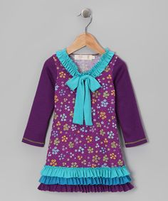 Offering a pop of color, rows of radical ruffles and plenty of personality, this dress is perfectfor playdates and other fun adventures. Soft, comfy fabric keeps kids smiling all day long.62% polyester / 33% rayon / 5% spandexMachine wash; hang dryMade in the USA