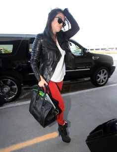 Red jeans with leather jacket.