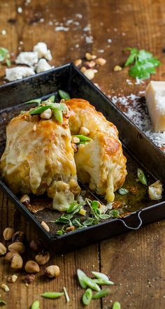 Whole Roasted Cauliflower with Three Cheese sauce and Crunchy Hazelnuts Califlower And Cheese, Cheese Sauce For Cauliflower, Roasted Califlower, Whole Roasted Cauliflower, Cheesy Cauliflower, Cauliflower Recipes, Veggie Recipes, Healthy Recipes, Cheesy Potato Casserole