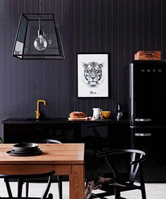 Smeg's fridge freezer in glossy black can bring a feeling of Cool Country to a minimalist bachelor pad.... Modern Country Loves: Smeg Fridges Click through for details.