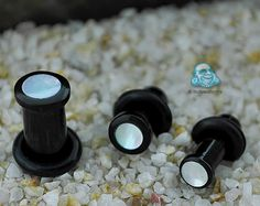 Single flare black horn plug with mother of pearl inlay