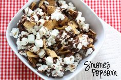 Smore's Popcorn: Pop 1 & 1/2 bags of Tender White Orville Redenbacher Popcorn. Mix with 1/2 box of Golden Graham cereal & 1/2 bag miniature marshmallows. Spread on cookie sheet. Melt 1 bag of chocolate chips in microwave & pour over dry mixture. gm