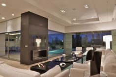 TV vs. Mantle // Design Inspirations and 4 simple tips - Cure Design Group Blog www.CureDesignGroup.com www.CureDesignGroup.com/wordpress #curedesigngroup #interiordesign #designtips #designinspirations #tvmountedoverfireplace