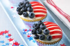 """""""Wave The Flag"""" Cupcakes  This patriotic pastry makes a memorable addition to any occasion.  For recipe: http://www.naturipefarms.com/index.php/RecipeDisplay/single/67"""