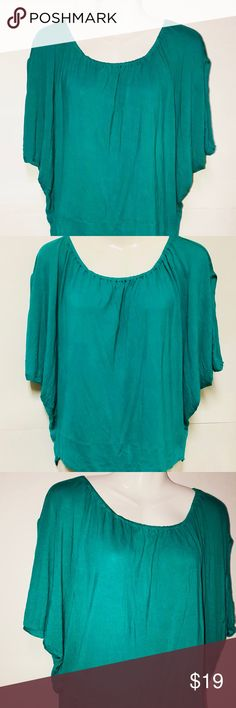 MNG by Mango Top MNG Mango Top. Flow fee of body elastic on a wide and low neck line. The fabric is real soft and smooth. Fitted at the hip. Preowned in very good, like new condition. Mango Tops Blouses