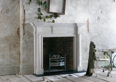 THE CHAMBERS The Chambers is an imposing mantel with engaged columns, doric capitals and breakfront corniced shelf.
