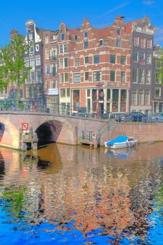 Reflections of the canal houses in an Amsterdam canal