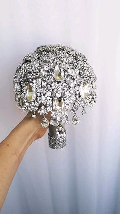 Bling crystal wedding bridal broach boquet Full price for gorgeous brooch bouquet of silver brooches in Gatsby style. Wedding Brooch Bouquets, Boquet Wedding, Bling Wedding Centerpieces, Bling Bouquet, Crystal Bouquet, Crystal Brooch, Broschen Bouquets, Non Flower Bouquets, Perfect Wedding