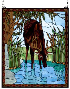 25 Inch W X 30 Inch H Deer Stained Glass Window - 25 Inch W X 30 Inch H Deer Stained Glass WindowIn a sparkling Turquoise river winding through MarshGreen field with cattails a Brown buck dips his headfor a drink. This picturesque scene is handcrafted of a beautiful selection of stained art glass. The Meyda Tiffany Original window is framed in a rustic Bark andLeather Brown diamond border. Brass mounting bracketand chains are included Theme: LODGE ANIMALS COUNTRY Product Family: Deer Product…