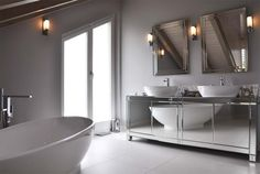 Contemporary bathroom with Visionnaire mirror furniture